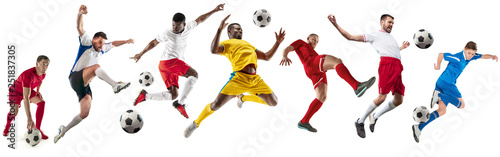 Fototapeta Professional football soccer players with ball isolated on white studio background