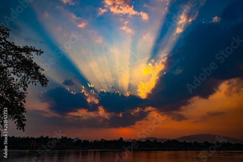 Canvas Prints Heaven Evening sun light Splash through the clouds over the river