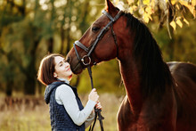 Woman With Her Horse At Sunset...