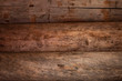 Background and texture of natural wood logs. The old wall is brown. Copy space.