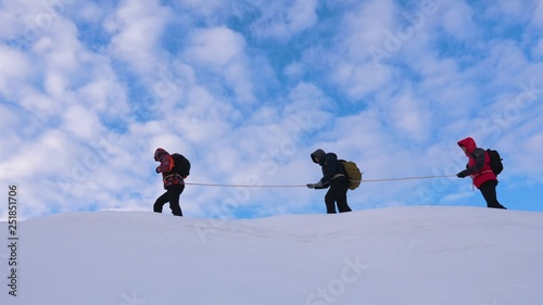 mountaineers go together after friend along snowy ridge Canvas Print