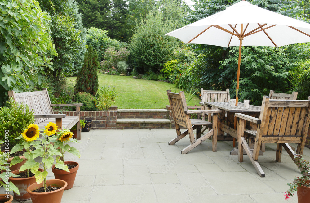 Fototapeta Patio with garden furniture and parasol
