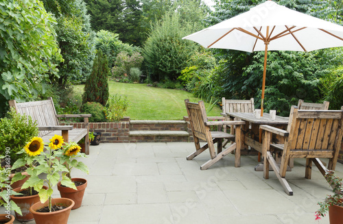 Patio with garden furniture and parasol - 251868790