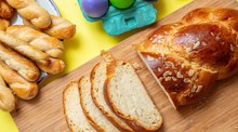 Easter Eggs And Tsoureki Braid, Greek Easter Sweet Bread, On Wood