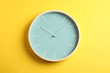 canvas print picture - Big beautiful stylish clock on yellow background, space for text
