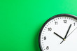 canvas print picture - Big beautiful office clock on green background, space for text