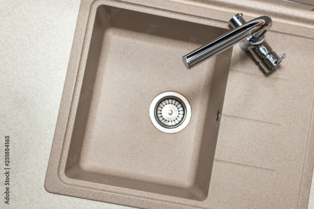 Fototapeta Granite kitchen sink with stainless two-handle faucet. Top view with copy space