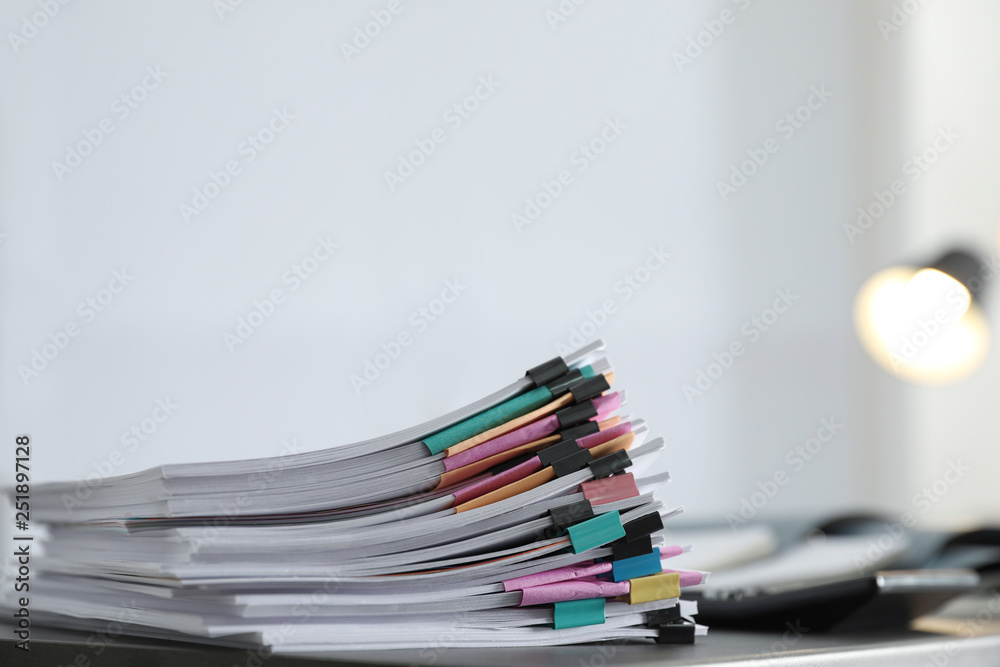 Fototapety, obrazy: Stack of documents with paper clips on office table. Space for text
