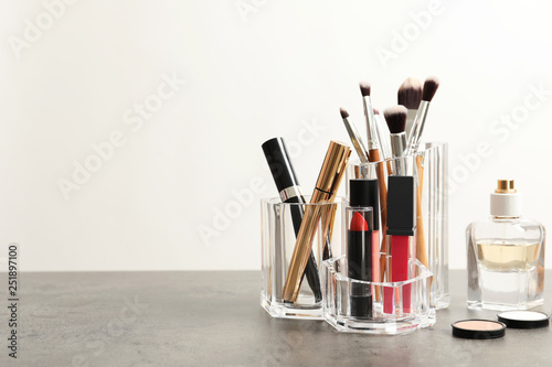 Photo sur Toile Amsterdam Lipstick holder with different makeup products on table against white background. Space for text