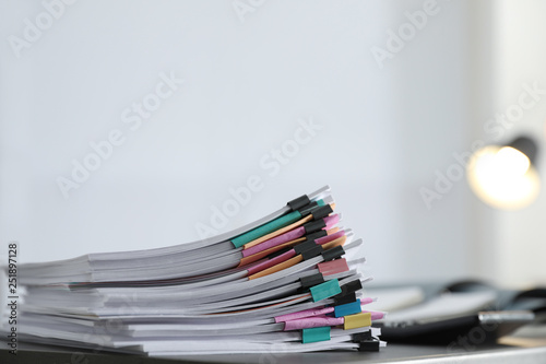 Fototapeta Stack of documents with paper clips on office table. Space for text obraz