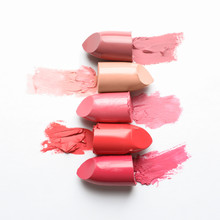 Different Lipstick Swatches On White Background, Top View