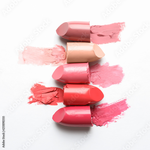 Different lipstick swatches on white background, top view Wall mural