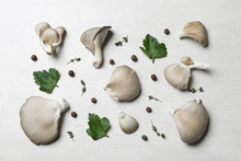 Flat Lay Composition With Delicious Organic Oyster Mushrooms And Leaves On Light Background