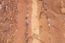 Red Sandstone Background With Embedded Pebbles