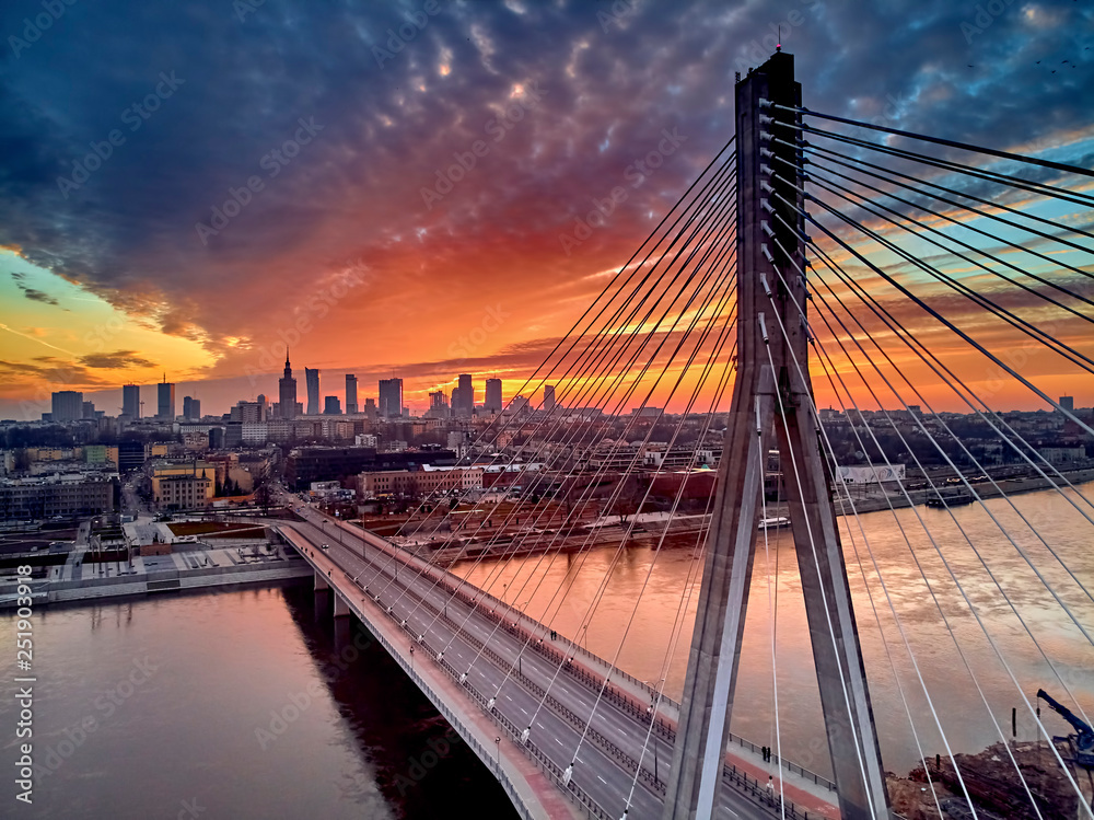 Fototapety, obrazy: Beautiful panoramic aerial drone sunset view to Warsaw city center with skyscrapers and Swietokrzyski Bridge (En: Holy Cross Bridge) - is a cable-stayed bridge over the Vistula river in Warsaw, Poland