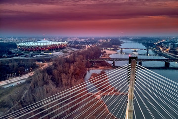 Fototapeta Mosty Beautiful panoramic aerial drone sunset view to The PGE Narodowy (official name) of National Stadium - Polish: Stadion Narodowy - football stadium located in Warsaw, Poland