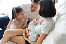 Happy Family Concept. Breast F...