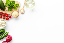 Fresh Organic Vegetables On White Background Top View Space For Text. Kitchen Desk For Preparing Salad