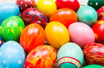 Fototapeta na wymiar Easter background with handmade colored eggs. Festive tradition