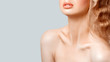 Beautiful young woman with fresh smooth glowing skin and perfect full lips isolated on grey background. Lips contouring, SPA therapy, skincare, cosmetology and plastic surgery concept. Hyaluronic acid