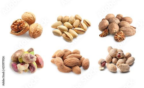 Fotomural  Assortment of tasty nuts on white background