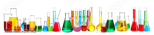 Laboratory glassware with color samples on white background