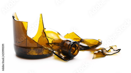 Fotografering  Glass shards, broken brown beer bottle isolated on white background
