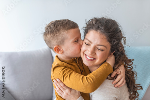 Fotografie, Obraz  Son is kissing his mother
