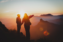 Mother And Son Travel In Mountains At Sunset, Family Hiking In Nature