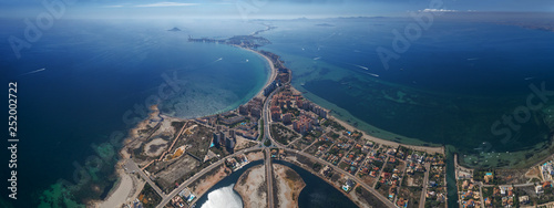 Fotografía Aerial panoramic photo of buildings, villas and the beach on a natural spit of L