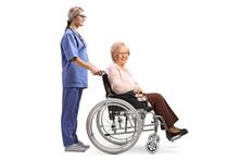 Nurse Pushing A Senior Woman I...
