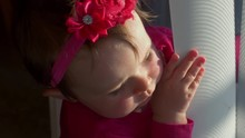 Adorable Little Girl Plays With Blinds At Window 4K