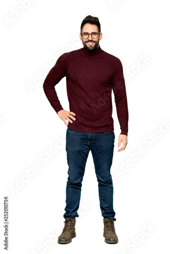 Full-length shot of Handsome man with glasses posing with arms at hip and smiling on isolated white background