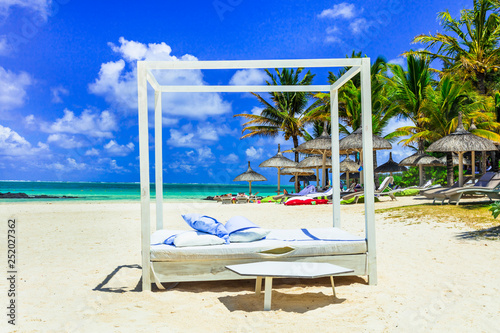 Relaxing tropical holidays. white sandy beach Bell Mare in Mauritius island