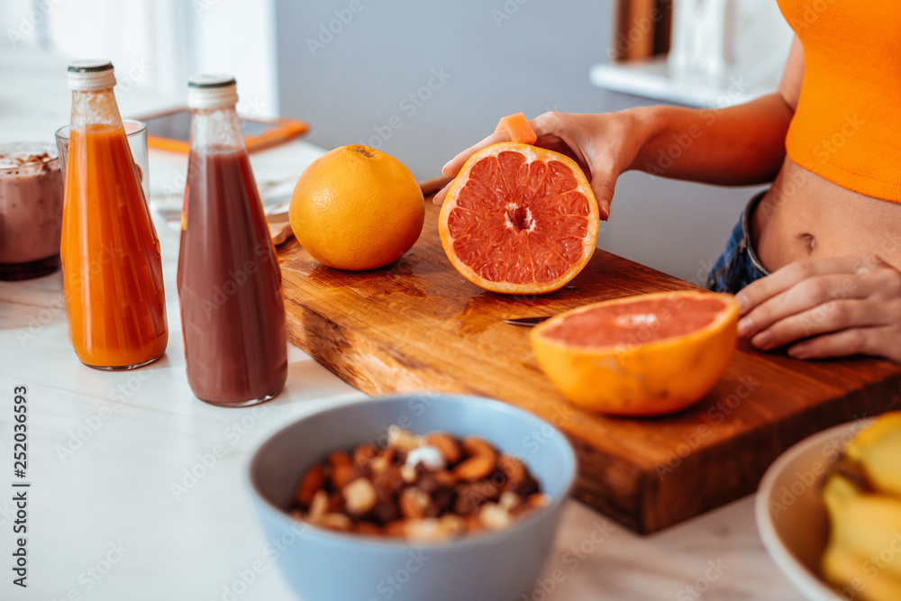 Fototapety, obrazy: Delicious tasty grapefruit lying on the cutting board