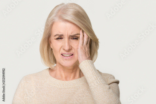 Fotografie, Obraz  Stressed upset middle aged woman suffering from terrible headache concept
