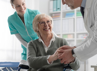 Doctor holding a patient's hands
