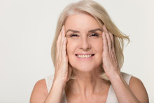 Happy Mature Woman Touching Face Isolated, Anti Aging Beauty Concept