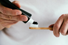 Man With A Black Toothpaste An...