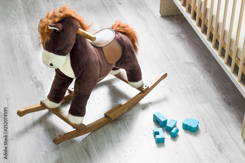 Rocking horse, crib at playroom Canvas-taulu