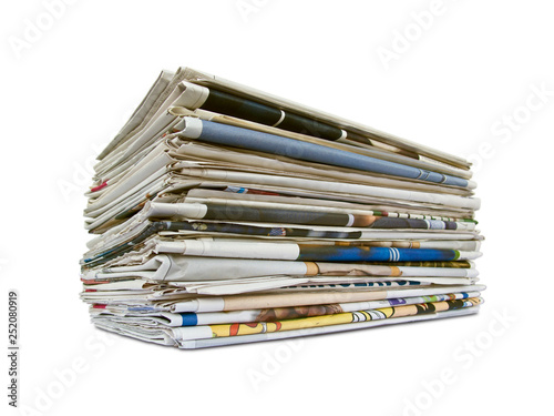 Fotografía  Stack of newspapers isolated on white