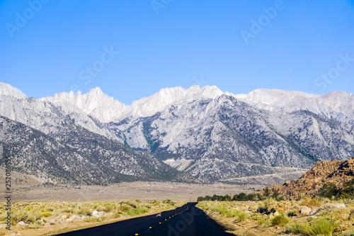 Newly rebuilt road leading towards Whitney Portal (rabbit crossing the road), Eastern Sierra Mountains, California