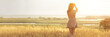 dreamy girl in a field at sunset, a young woman in a haze from the sun enjoying nature, romantic style