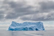 Iceberg Under Darkening Sky