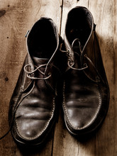 Unlaced Men's Boots On Wood Fl...
