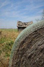Abandoned House Behind A Hay B...
