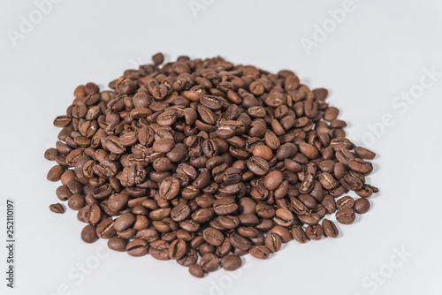Aluminium Prints Coffee beans a pile of coffee beans on a white background