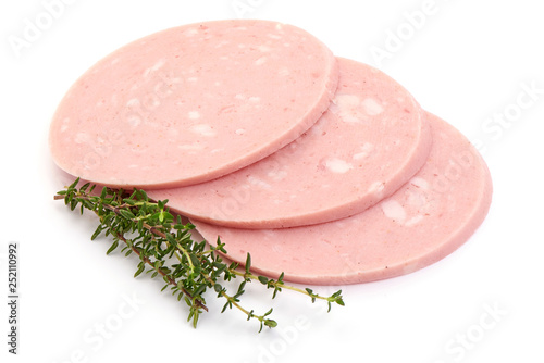Fotografía  Boiled sausage slices with rosemary, close-up, isolated on white background