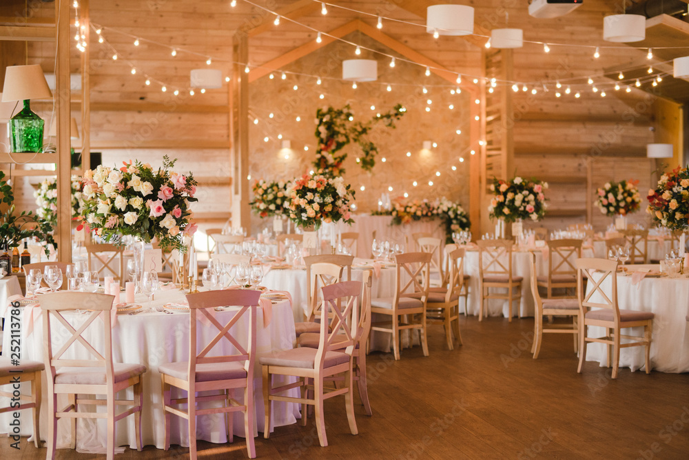 Fototapety, obrazy: Coziness and style. Modern event design. Table setting at wedding reception. Floral compositions with beautiful flowers and greenery, candles, laying and plates on decorated table.
