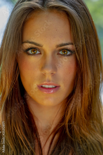 Fotografie, Tablou  Headshot Of A Beautiful Brunette Model Poses In An Outdoor Environment